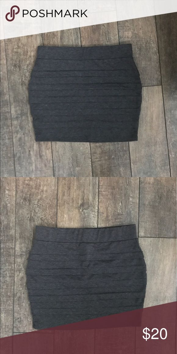 Grey body con skirt Great for summer or a night out!  79% poly, 18% rayon, 4% spandex WINDSOR Skirts Mini