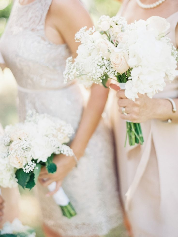 Bridesmaids Bouquets of Baby's Breath and Roses    On SMP: http://www.StyleMePretty.com/2014/02/20/williamsburg-virginia-wedding/  Laura Gorden Photography