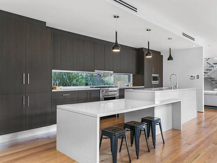 Modern white black kitchen with island table