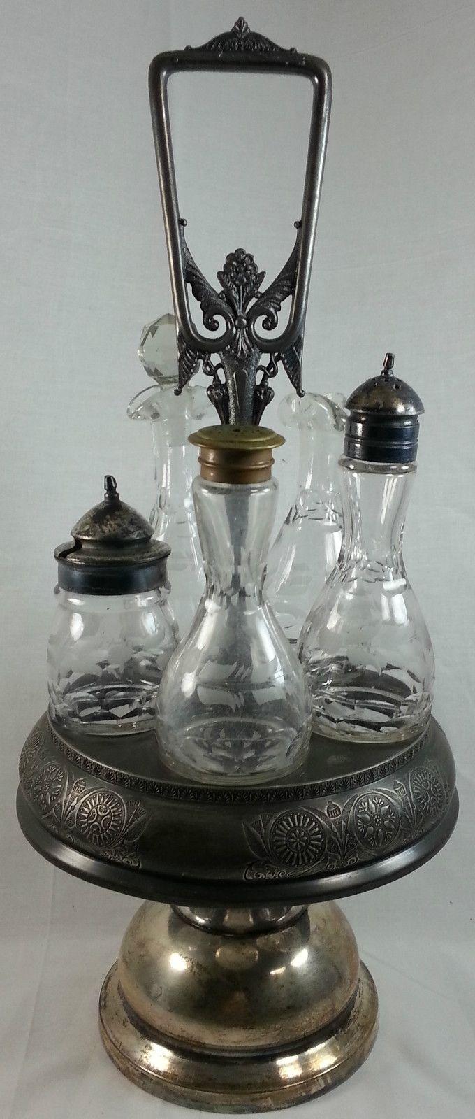 Antique castor cruet set 5 etched glass bottles rogers co for Antique decoration items
