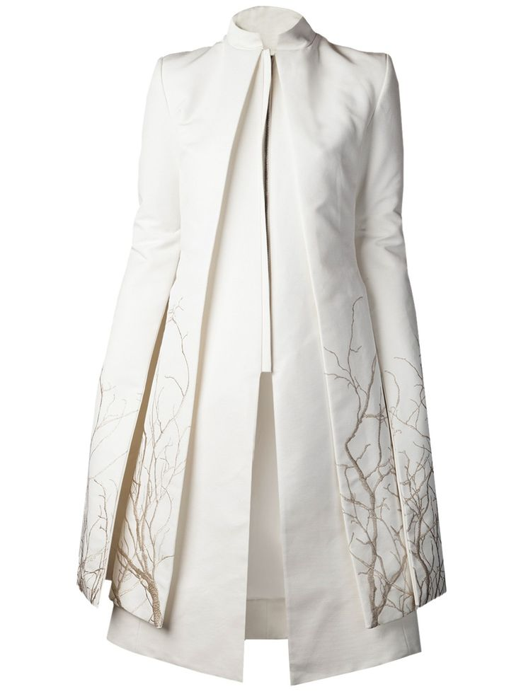 White cotton blend coat from Gareth Pugh featuring a mandarin collar, layered design throughout, and hem with sleeve metallic tree embroidered details throughout. Mandarin collar.