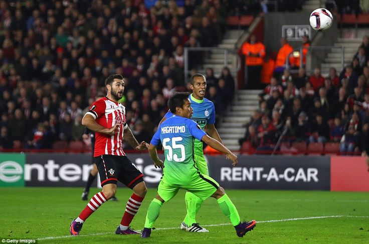 Southampton substitute Charlie Austin watches on as the ball bounces offYuto Nagatomo and heads towards Inter's goal
