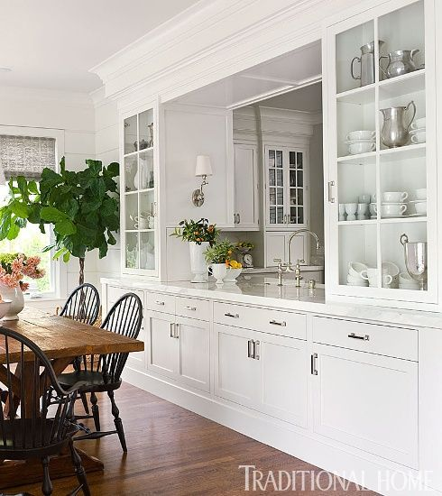 "Colonial farmhouse touches ... I love the ""window"" into the kitchen. Much cozier than completely opening things up."