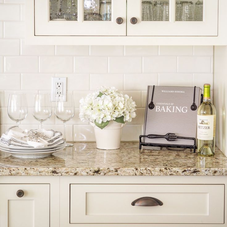 Venetian Gold Light Granite with off white subway tile and off white cabinets. Cabinet color is a close match to Sherwin Williams- Dover White.