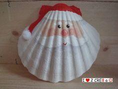 kerstman, verf en pompon op St Jacobsschelp