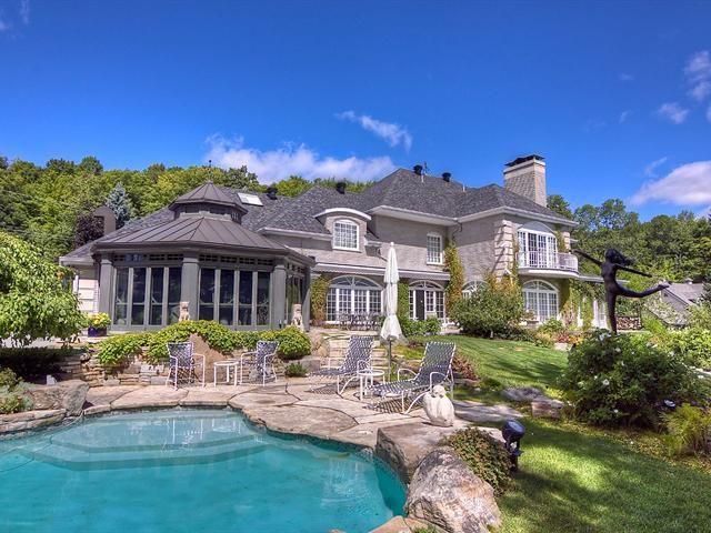 NOUVEAUTÉ SUR LE MARCHÉ ! Majestueuse demeure au bord du lac Guindon, Ste-Anne-des-Lacs - 2 898 000 $