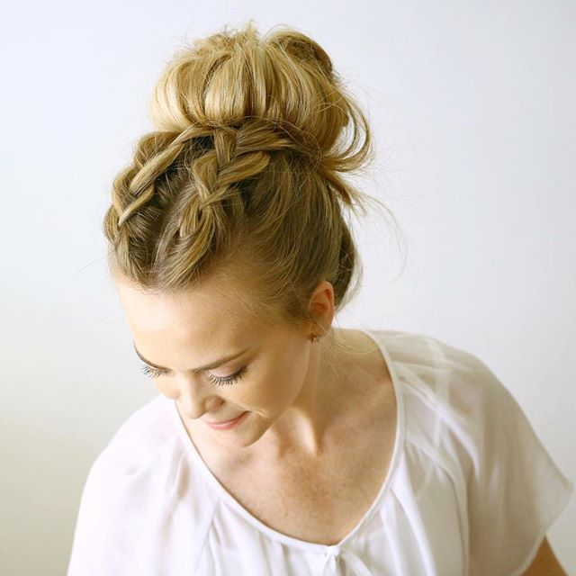 Two Dutch Braids into a messy bun today There isn't a tutorial yet but I've…