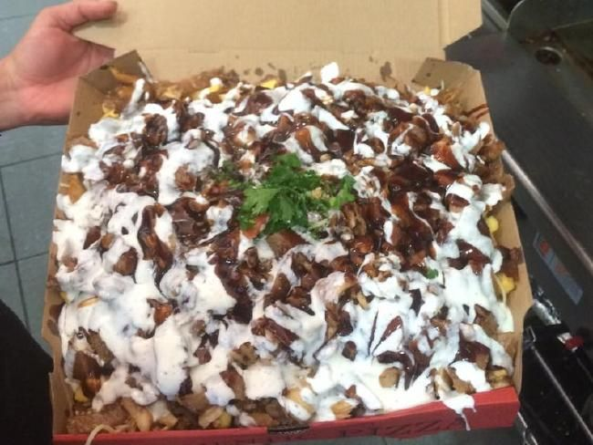 Or if you want the big one, you might find it comes in a pizza box. Picture: Facebook/Halal Snack Pack Appreciation Society