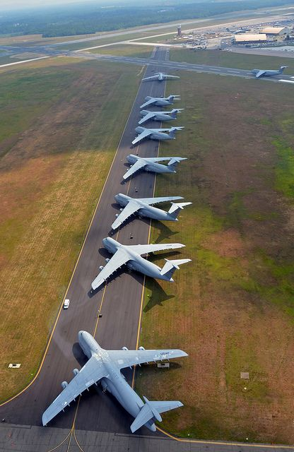 Air show parking U.S. Air Force C-5 Galaxies cargo aircraft aligned on a Westover, Mass. Air Reserve Base runway.