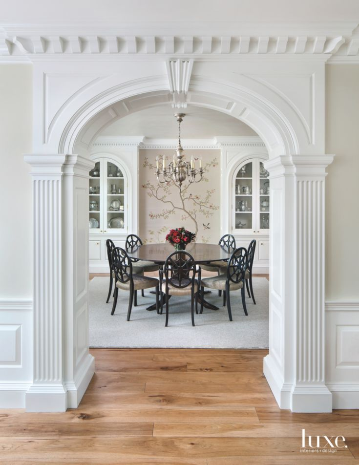 Traditional White Ornate Arch Entrance To Formal Dining