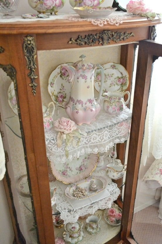 beautiful curio but a bit overdoneon the lacey doilies. love it,just like mama's