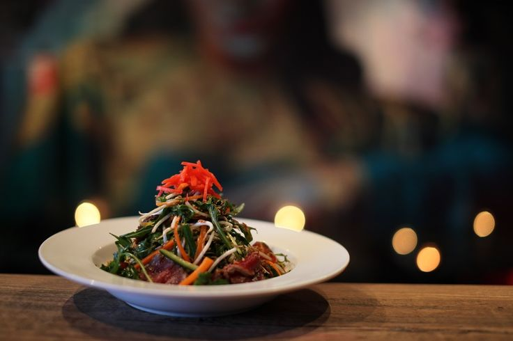 THAI BEEF SALAD    Meat from the A La Carte Menu     Rare style carpaccio of eye fillet, marinated in soy and Asahi tossed with rocket, been sprout, carrot, cucumber, chilli, tomato and fresh herbs and englossed in a traditional Asian dressing
