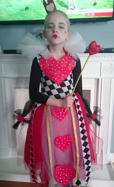 Ruby from London taking her role seriously as the Queen of Hearts from Alive in Wonderland. Her mum made this costume!