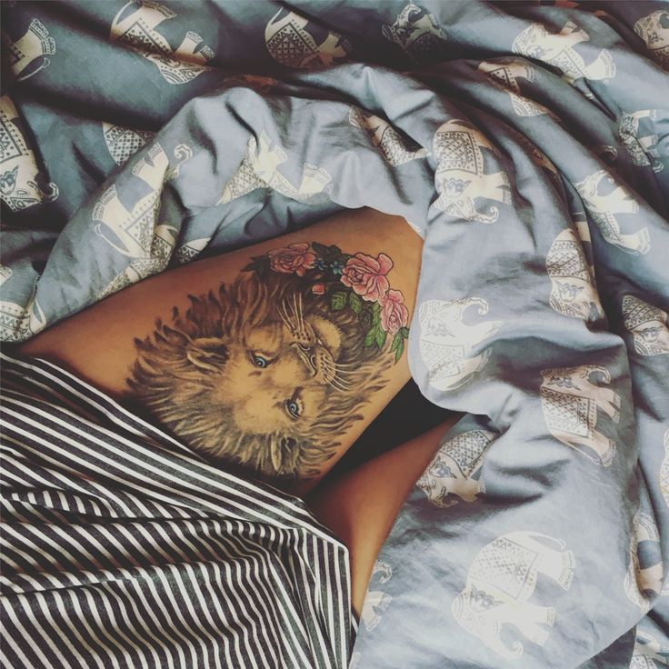 Lion thigh tattoo