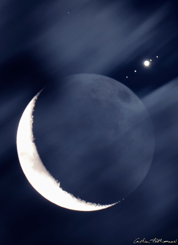 """Skygazers around planet Earth enjoyed the close encounter of planets and Moon in July 15's predawn skies. [...] Clouds threaten in this telescopic view from Montecassiano, Italy, but the frame still captures Jupiter after it emerged from the occultation along with all four of its large Galilean moons."""