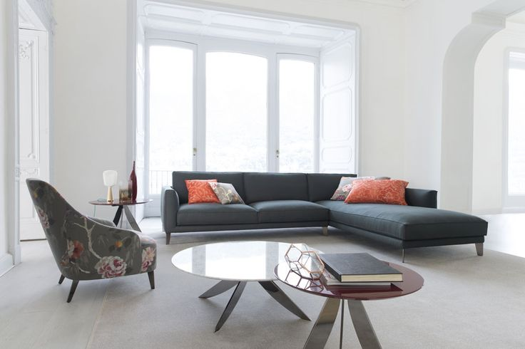 Emilia armchair and Time Break sectional sofa.