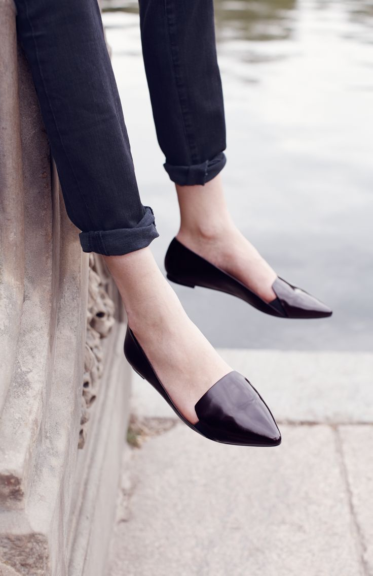 Black jeans and classic flats.