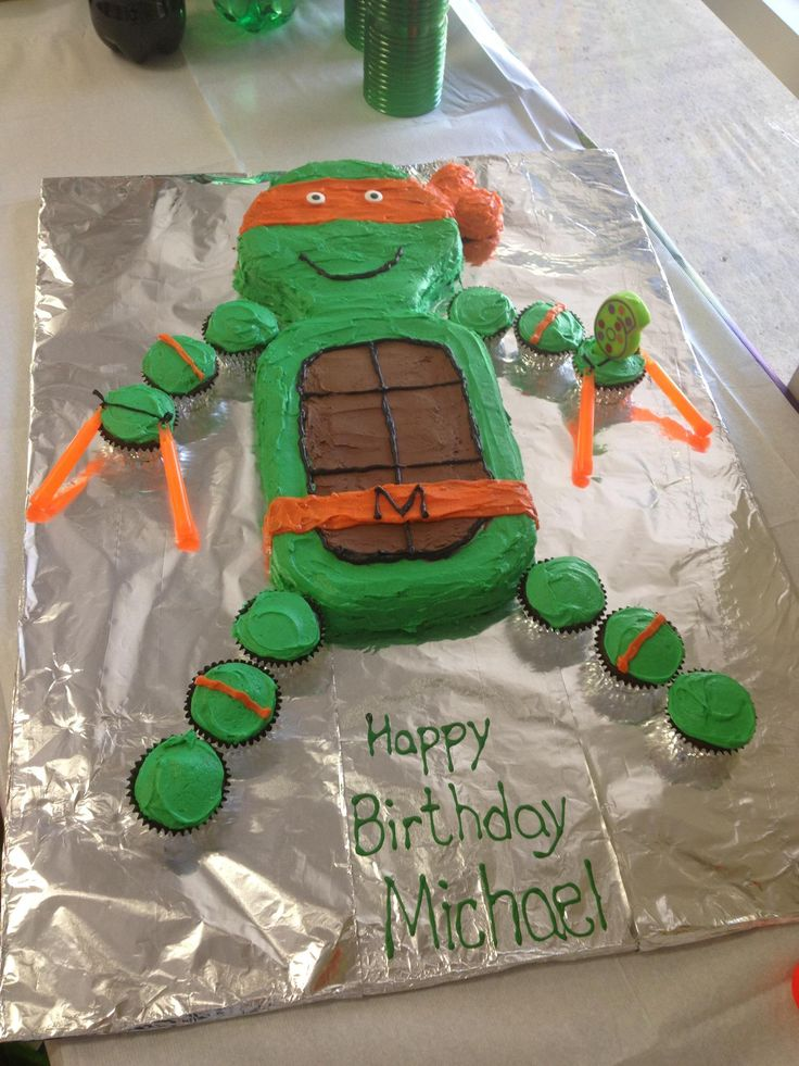 I made this TMNT birthday cake for a friends son's 6th birthday party. It was a lot of fun to make and easy to do. It's a chocolate cake with buttercream icing. The best part is that I used orange glow sticks for the nunchucks. Oh, and it tasted great too!