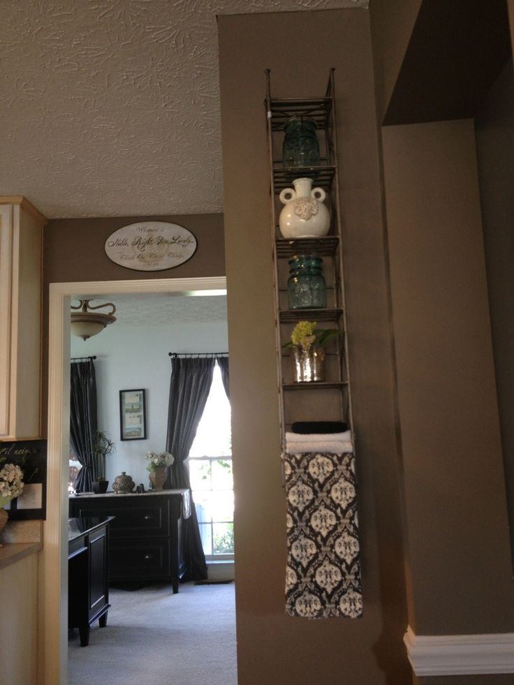 Upcycling: CD Tower as a Shelf>> Two Mason Jars, the little white vase, the pretty towel and the CD rack…total of $24:
