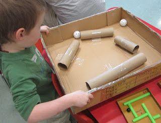 Maneuvering small plastic golf balls through tunnels