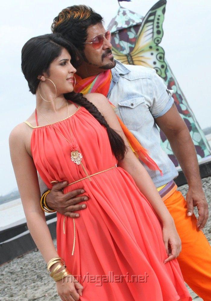 Deeksha Seth and Vikram in Rajapattai movie still