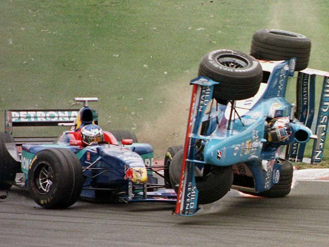 Alexander Wurz flies over Olivier Panis' Peugeot during a crash after the start of the Canadian Grand Prix in 1998.