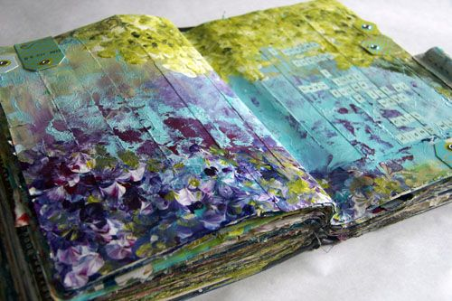 """""""this started with strips of scrap paper glued to the background and once i painted over the entire background with green, turquoise and magenta i then, purposely closed the book so the paint would smush in between the pages."""" Donna Downey"""