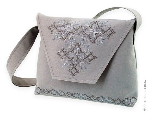Grey purse with playful embroidery in grey hues