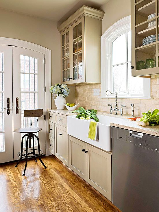 This monochromatic color scheme works well; the white brings it up and the gray specks of color in the countertop get picked up by the steele in the DW and the warm undertones of the wood floor.