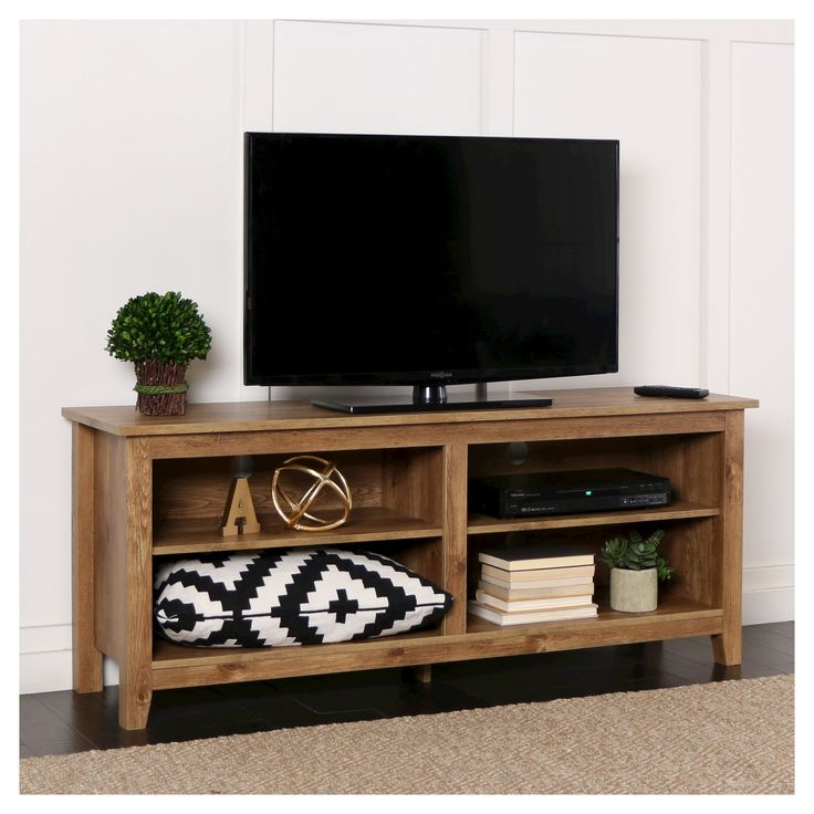 Display your TV in style with this wood media stand. Crafted from high-grade MDF with a durable laminate finish available in many colors to fit your home décor. Features adjustable shelving to fit your media components and accessories with a cable management system to help maintain a tidy entertaining space. Console will accommodate most flat-panel TVs up to 60 inches. <br><br>Features:<br>• Rich, textured finish<br>• High-grade MDF and durab...