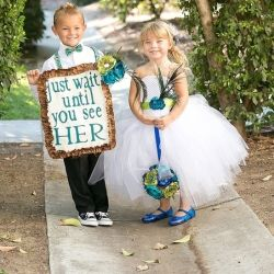 These two little ones are stealing the show in this teal & peacock feather stunner!