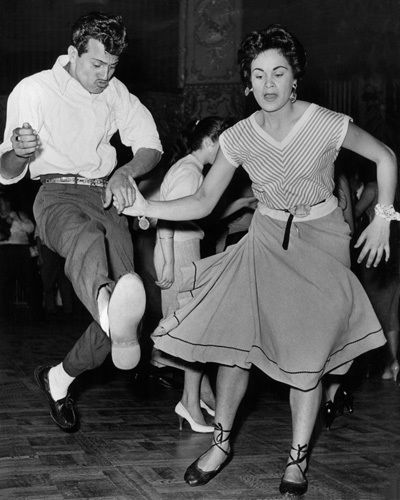 Rock'n roll is a type of music, is popular in the years of 50s - 60s. Rock'n roll dancing is more free, more breaking than before. that's why the women adore the big volume skirt