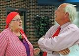 Clinton School District teacher Karla Byl talks to Eagle Heights Elementary Principal Roger Winterlin on Monday at Clinton High School during the ceremony honoring Byl and 11 of her fellow Clinton School District staff members. / Clinton Herald