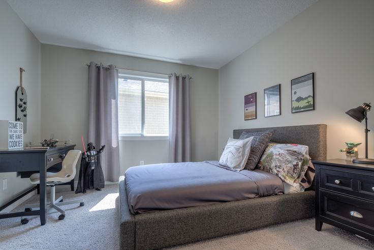 One of the large secondary bedrooms in this home - perfect for your teen.