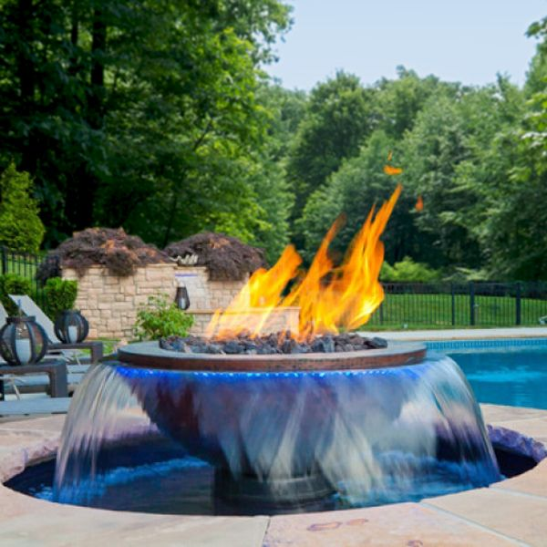 "More than just a simple waterspout, the 360° scupper that tops this fountain provides a steady shimmering skirt of liquid pleasure for your eyes and ears, tickled further by a flickering full flame! The Evolution 360™ from Maddox® is a 52"" diameter ready-to-finish PVC resin basin with adjustable leveling feet, and a center pillar that is topped by a solid copper f..."