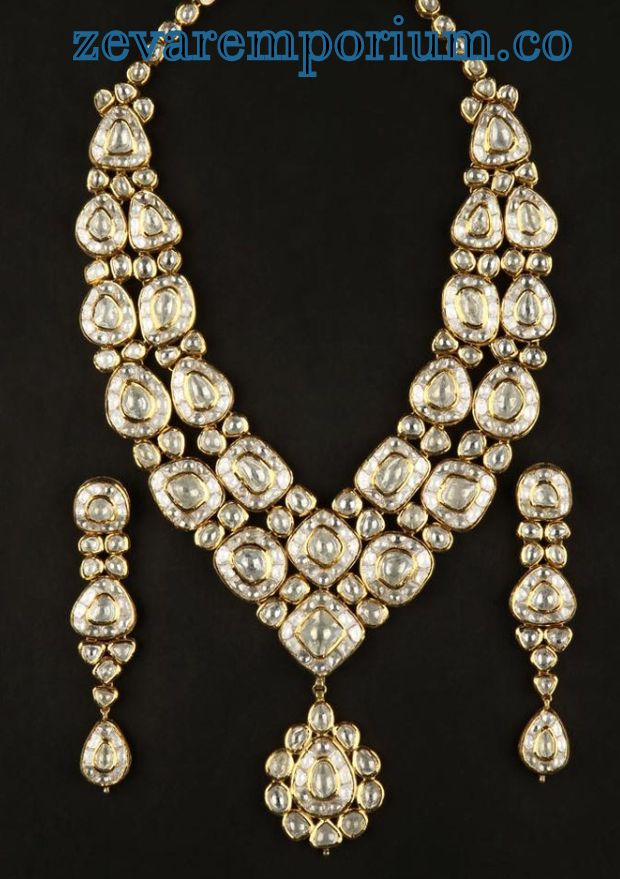 inlaid Pearl encrusted with diamond polki and gold.