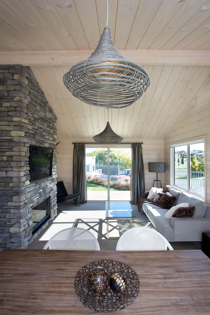 Lockwood Stewart show home featuring stone fireplace  in living area.