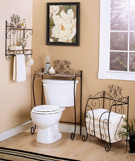 "Love the towell holder!       Item#: 975076-1YTS Size & ColorOverviewAAA  Beautiful Butterfly Bathroom Collection makes great use of space while adding a new look to your interior. Decorative and functional, these scrolled metal and wicker-look storage pieces feature graceful thin lines with plenty of shelving space. The Over-The-Toilet Storage (39-3/8"" x 23-1/2"" x 12-1/2"") conveniently fits over the toilet to provide extra space for toiletries, boxed tissue and more. The Bathroom Shelf ("