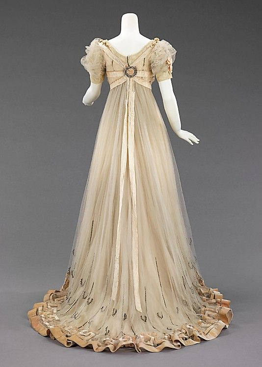 Dress, Evening  House of Paquin  (French, 1891–1956)  Designer: Mme. Jeanne Paquin (French, 1869–1936) Date: 1905–7 Culture: French Medium: silk, silver, rhinestones Dimensions: Length at CB: 72 in. (182.9 cm) Credit Line: Brooklyn Museum Costume Collection at The Metropolitan Museum of Art, Gift of the Brooklyn Museum, 2009; Gift of Sarah G. Gardiner, 1941