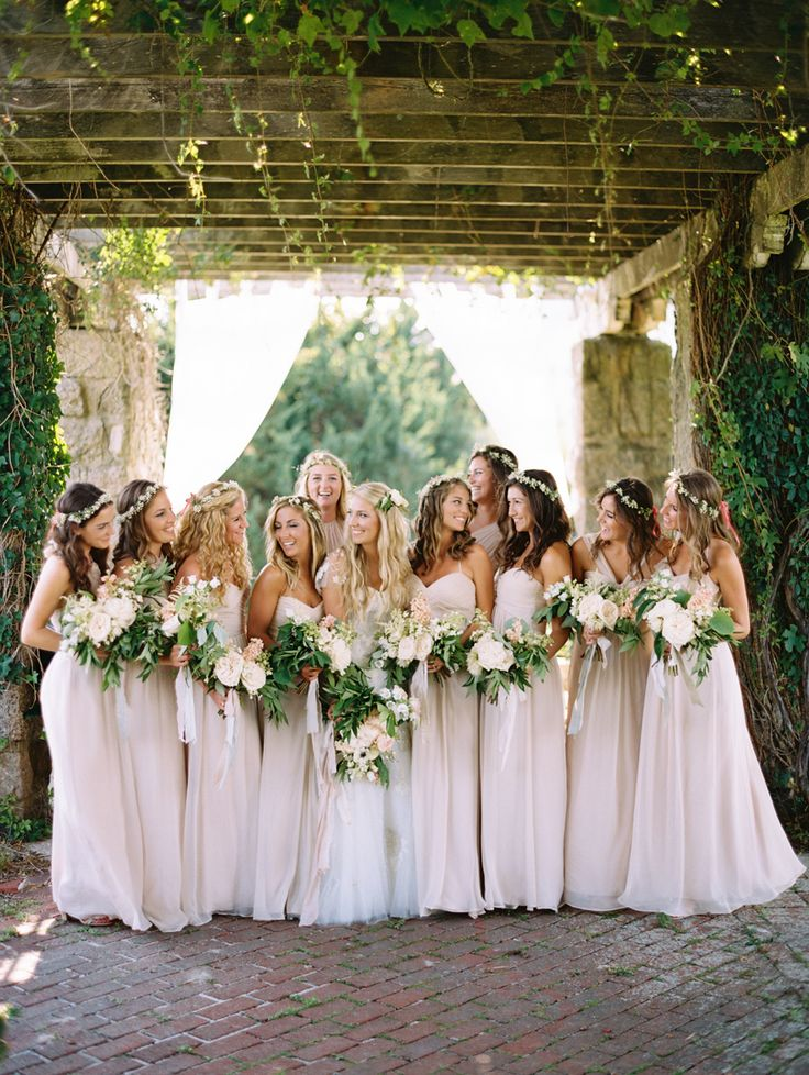 Rustic meets garden-inspired bridesmaid looks: http://www.stylemepretty.com/2015/12/31/editor-picks-the-best-real-weddings-of-2015/