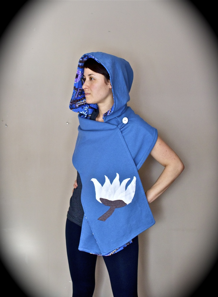 With an attention to detail, Isomi Henry's handmade designs, such as this #blue #scarf with #white #lotus #flower, feature repurposed fabrics. See more at Danforth East Arts Fair in Toronto's East Lynn Park.