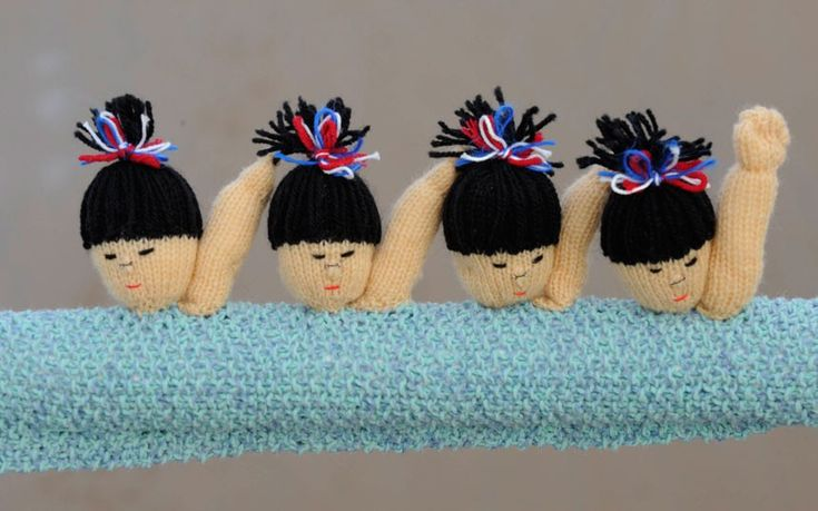 Synchronised knitted swimmers