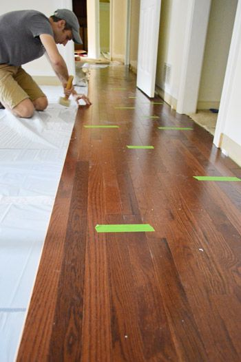 Install hardwoods with Elastilon underlayment. You can install hardwood floors on concrete slab with Elastilon!! Product as seen by Young House Love.