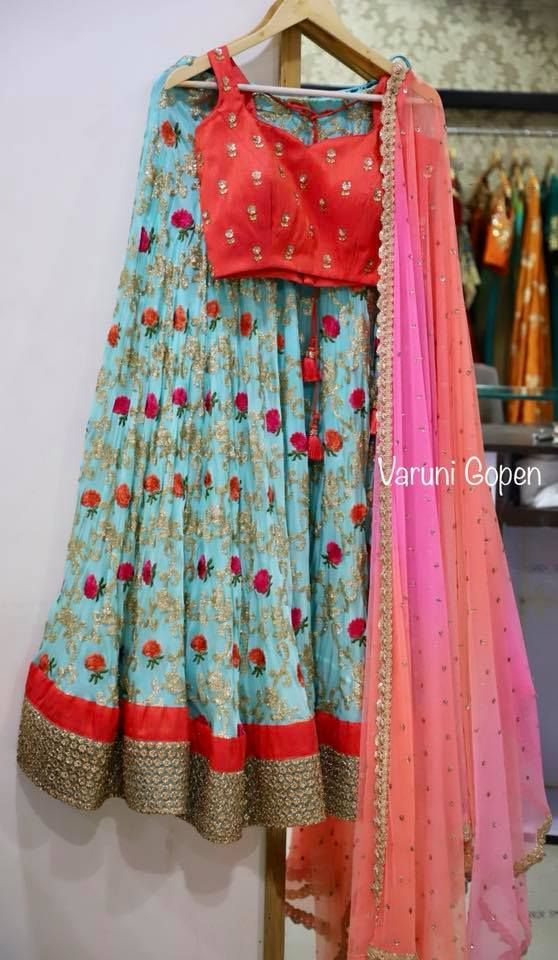 Beautiful powder blue color designer lehenga and red color crop top with pink color net dupatta. Lehenga with floret lata design hand embroidery thread work. 11 November 2017