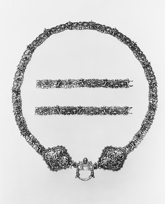 """Girdle: ca. late 16th or early 17th century, French, Strasbourg, silver gilt. """"Purses, rosaries, prayer books, and other small accessories were hung from girdles, which were often given as wedding gifts. The girdle and its two extensions feature the same decorative scheme of cast cupids and foliated scrolls."""""""