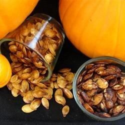 Don't toss those seeds from preparing pumpkins; maple and cinnamon-spiced baked pumpkin seeds make a unique snack for fall.