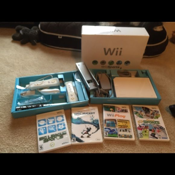 Wii console with 4 games I have a basically new Wii console with 4 games that have only been played maybe 3 times since I bought it. Still have the box and no scratches on the discs. Accessories