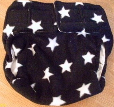 Wahm star fleece nappy wrap with PUL inner and fastens with Aplix (velcro)