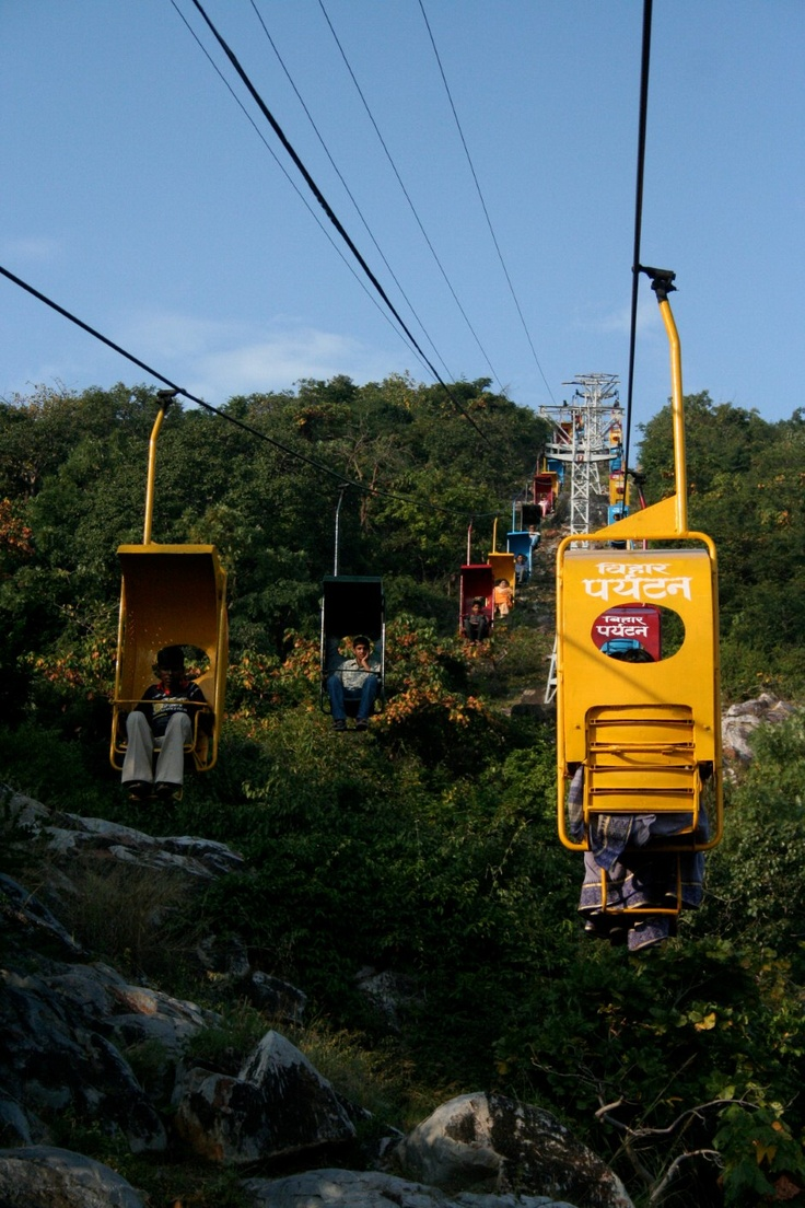 Pilgrims and tourists make their way up Gridhakuta Hill in rickety cable cars in Rajgir, Bihar.