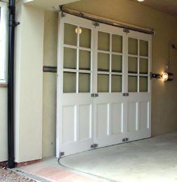 Round the corner garage door to avoid overhead clearance problem